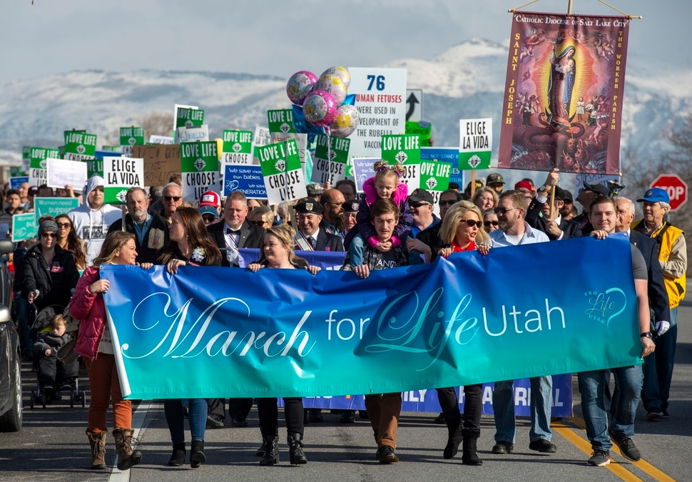 (Rick Egan | The Salt Lake Tribune) Hundreds of marchers walk down 300 North in front of the Utah State Capitol, in the March for Life Utah rally, Saturday, Jan. 25, 2020.