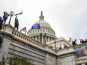 (Jason Andrew | The New York Times) Protesters on the Capitol in Washington on Wednesday, Jan. 6, 2021. The Capitol was placed on lockdown, with senators and members of the House locked inside their chambers, as Congress began debating President-elect Joe Biden's victory. President Trump addressed supporters near the White House before protesters marched to Capitol Hill.