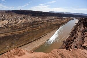 (Francisco Kjolseth  | The Salt Lake Tribune) The Hite Marina boat ramp, center, sits idle hundreds of yards from the river's edge where the Colorado River flows into Lake Powell on Thursday, Feb. 4, 2021. A new investment fund aims to finance technology startups focused on conserving water.