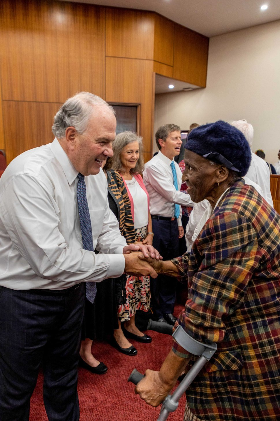 (Photo courtesy of The Church of Jesus Christ of Latter-day Saints) Elder Ronald A. Rasband of the Quorum of the Twelve Apostles interacts with a South African Latter-day Saint during his ministry trip there in February 2020. There are over 65,000 church members and 190 congregations in the country.