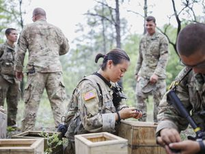 (Melissa Golden | The New York Times) Army cadets sort the spent shells and machine gun links collected after a training exercise, at Fort Benning, near Columbus, Ga., April 30, 2017. Utah Sen. Mike Lee opposes a bill that would require women to register for the draft.