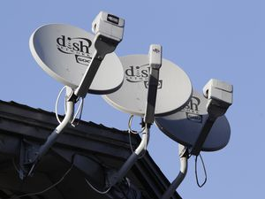 FILE - In this Feb. 23, 2011, file photo, Dish Network satellite dishes are shown at an apartment complex in Palo Alto, Calif.  (AP Photo/Paul Sakuma, File)