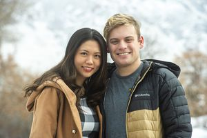 (Rick Egan | Tribune file photo) In this Dec. 18, 2020, file photo, Jialing and Josh Bird, pose outside their apartment in Provo. The couple in the last round of relief aid received $1,200 — half the amount that other couples received because of confusion or government mistakes over Jialing's legal residency status. The new relief package approved Monday night by Congress fills in some of the gaps that excluded mixed immigration status families in the first round.