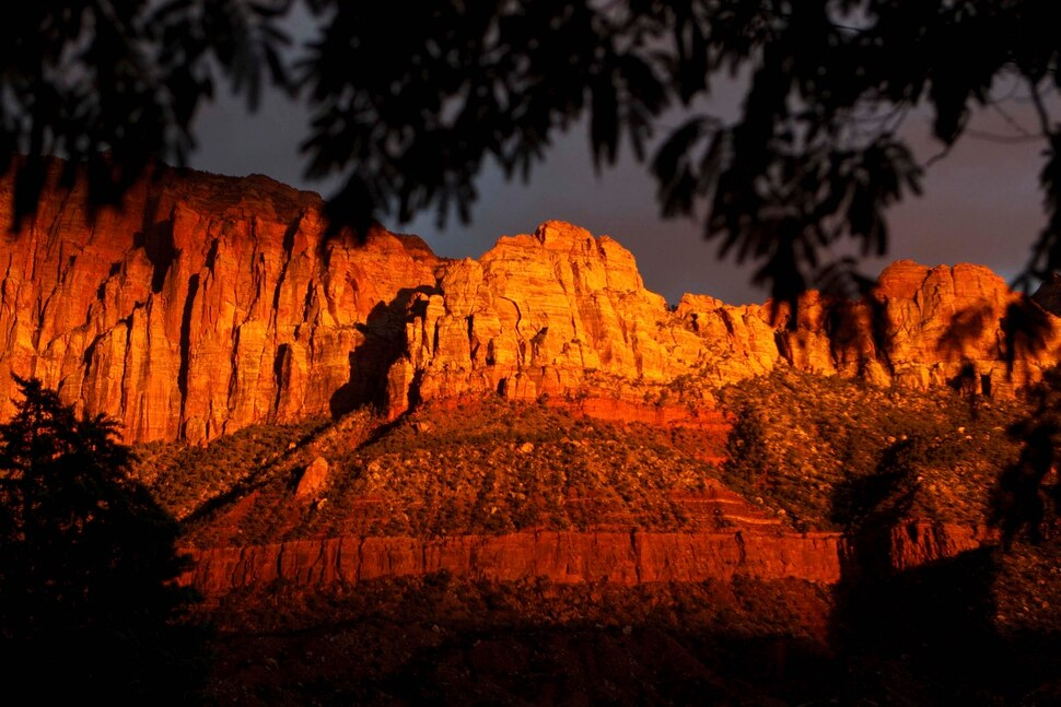(Trent Nelson | The Salt Lake Tribune) The sun sets on peaks overlooking Springdale, Thursday, October 10, 2013.