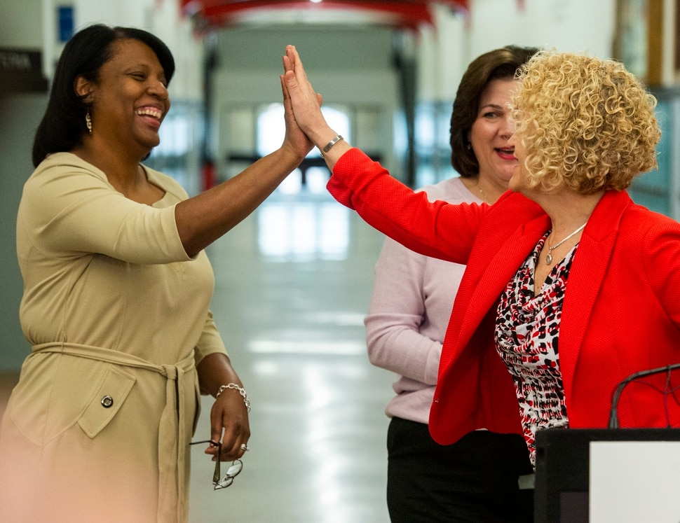 (Rick Egan | The Salt Lake Tribune) Mayor Jackie Biskupski gives a high five to Rep. Sandra Hollins after announcing a new school resource officer initiative at West High School, Tuesday, March 26, 2019.