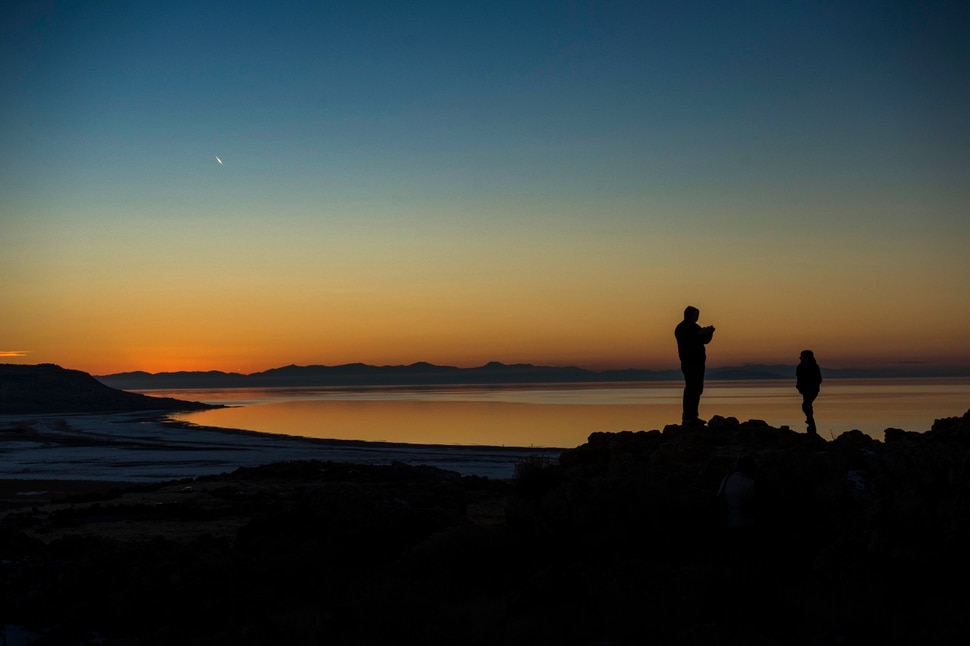 (Rick Egan | The Salt Lake Tribune) Tourists take photos on Antelope Island as the Sunsets over the Great Salt Lake, minutes before the largest and brightest supermoon of 2018 rose over the Wasatch mountains, Monday, January 1, 2018.
