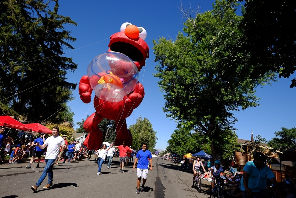 (Francisco Kjolseth | The Salt Lake Tribune) Thousands line the streets as they take in the floats and character that makes up Utah County during the America's Freedom Festival Grand Parade on Wed. July 4, 2018, in Provo.