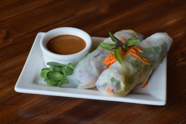 (Courtesy of Bobbie Henderson at Ginger's Garden Cafe and Ginger's Truck) Ginger's Truck vegan spring rolls are made with marinated tofu, fresh basil, cabbage, carrot shreds, micro greens and black sesame seeds. They are rolled into a sticky rice paper served with spicy peanut sauce.
