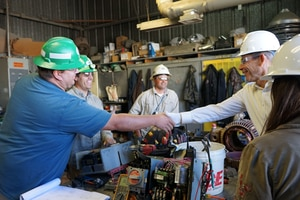 (Courtesy of Rep. John Curtis) Rep. John Curtis (right), R-Utah, shakes hands with an employee at Energy Fuels' White Mesa uranium mill in September 2019. Some $75 million for a reserve uranium was included in the massive spending bill passed by Congress this week.