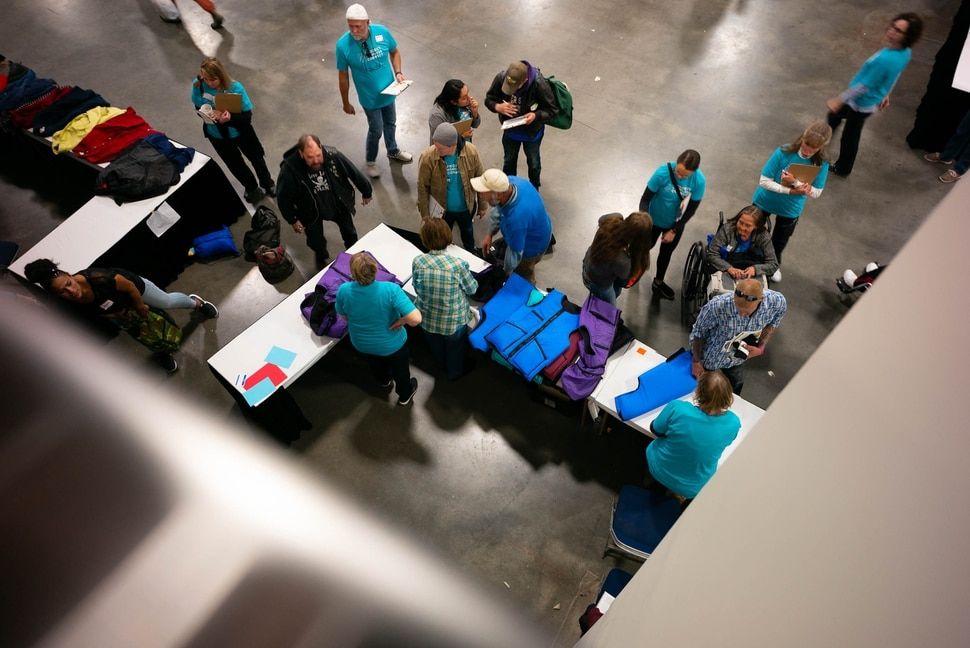 (Trent Nelson | The Salt Lake Tribune) Clothing is handed out at Project Homeless Connect, where community volunteers to provide services for individuals and families experiencing homelessness, at the Salt Palace Convention Center in Salt Lake City on Friday Oct. 25, 2019.
