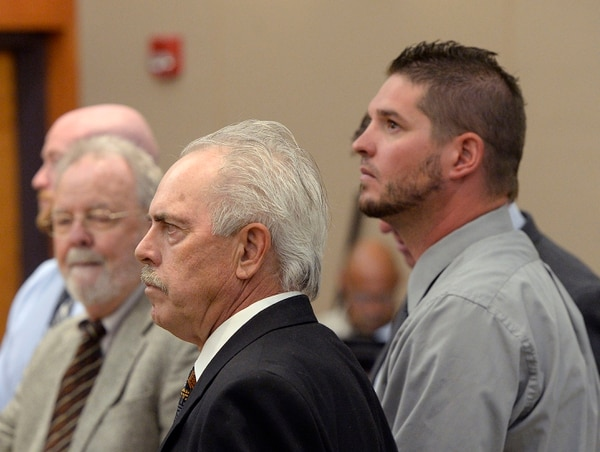 Al Hartmann | The Salt Lake Tribune Former Daggett County Sheriff Jerry Jorgensen, center, huddles with lawyers and former jail commander Lt. Benjamin Lail, right, in Third District Court in Park City Monday July 17 before Judge Kent Holmberg on charges connected to the abuse of jail inmates at the Daggett County jail. A third person charged ar far left is Deputy Joshua Cox.