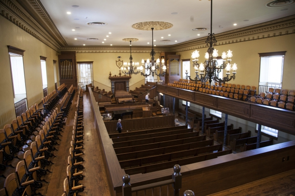 In this July 23, 2018 photo, community members tour the St. George Tabernacle after two years of renovations to preserve and secure the historic building in St. George, Utah. The historic Mormon church building in southern Utah has re-opened its doors after a two-year project to restore the tabernacle built by early settlers even as the new town struggled to survive through floods and heat, the Spectrum newspaper reports. (Chris Caldwell/The Spectrum via AP)