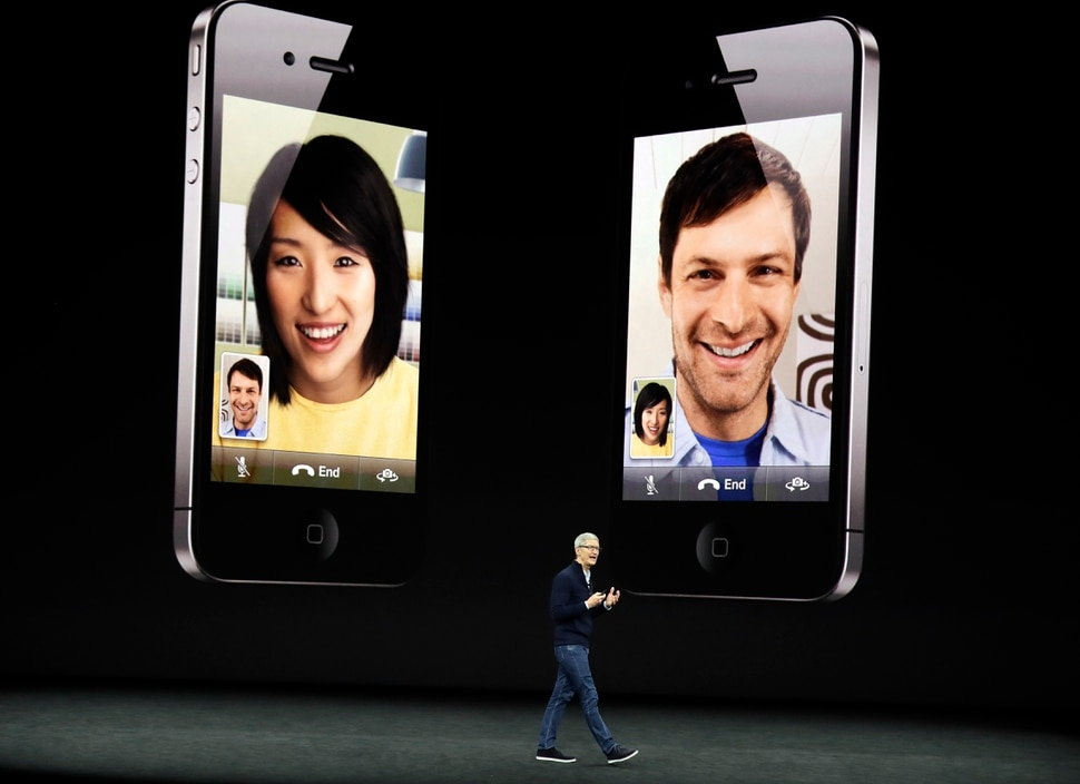 Apple CEO Tim Cook discusses the new iPhone 8 at the Steve Jobs Theater on the new Apple campus, Tuesday, Sept. 12, 2017, in Cupertino, Calif. (AP Photo/Marcio Jose Sanchez)