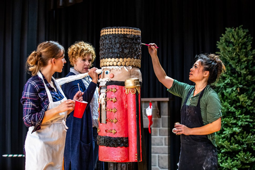 (Courtesy photo) Baking assistant, Becca Pickup (left) helps Brenda Nibley and Alisha Nuttall, put the finishing touches on a life-size nutcracker, during an episode of Holiday Cookie Builds, Season 1.