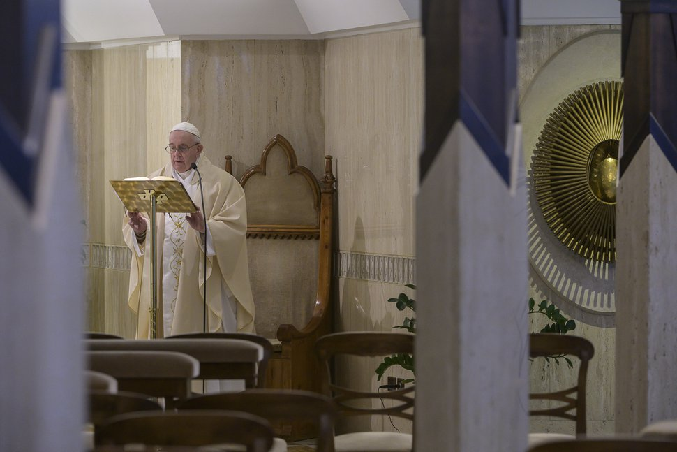 (Vatican News via AP) Pope Francis celebrates Mass at his Santa Marta residence, at the Vatican, Wednesday, March 25, 2020.