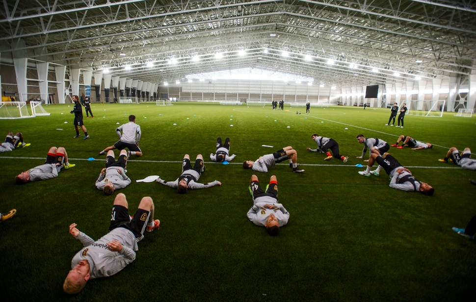 (Steve Griffin | The Salt Lake Tribune) RSL players stretch before practice begins at the Zions Bank Real Academy indoor facility in Herriman Tuesday January 23, 2018.