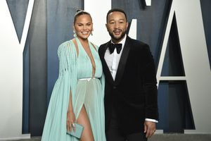 "(Photo by Evan Agostini/Invision/AP, File)  This Feb. 9 photo, Chrissy Teigen, left, and John Legend arrive at the Vanity Fair Oscar Party in Beverly Hills, Calif.   Teigen and Legend have revealed the ""deep pain"" they are feeling, over the loss of their unborn baby following pregnancy complications. Teigen announced their loss on her social media accounts early Thursday, Sept. 30, saying they were ""driving home from the hospital with no baby. This is unreal."""