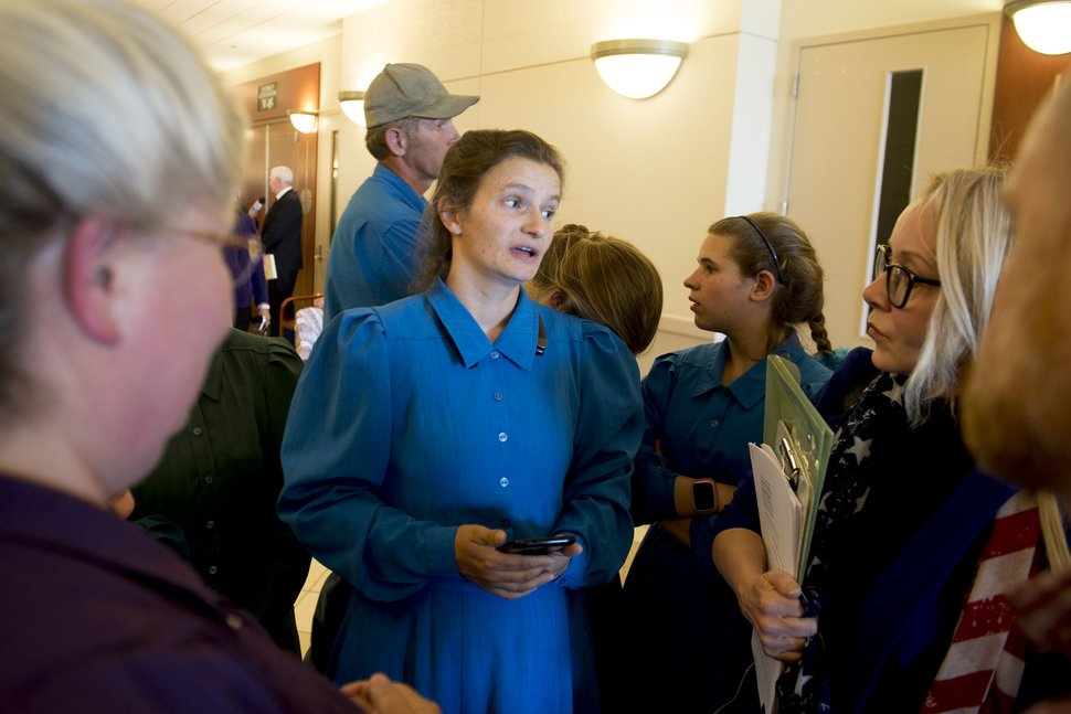(Jeremy Harmon   The Salt Lake Tribune) Lori Barlow, center, talks to Christine Katas, right, after a UEP hearing in Salt Lake City on Tuesday, June 18, 2019.