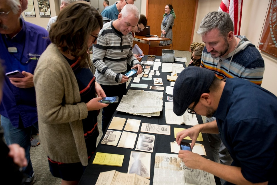 (Jeremy Harmon | The Salt Lake Tribune) People view items from a time capsule that was buried in the corner stone of Ogden Academy on September 27, 1887. Items from the time capsule were displayed at the Utah State Archives on Wednesday, Oct. 16, 2019.