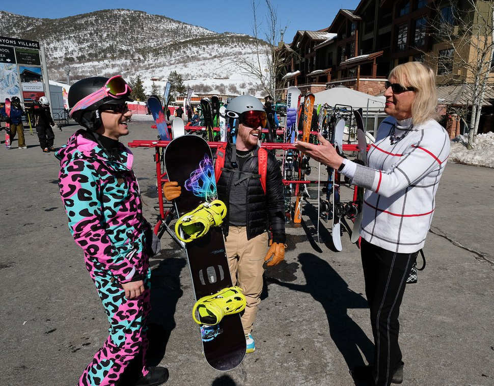(Francisco Kjolseth | The Salt Lake Tribune) Visiting Park City Mountain Resort, Jesse Iglesias, left, of Seattle, and Scot Harrell, of Austin, speak with Cami Richardson, a greeter at the resort, on Feb. 28.