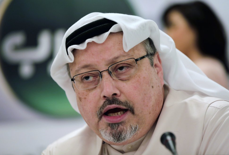 FILE - In this Dec. 15, 2014, file photo, Saudi journalist Jamal Khashoggi speaks during a press conference in Manama, Bahrain. President Donald Trump says the U.S. will not levy additional punitive measures at this time against Saudi Arabia over the killing of Jamal Khashoggi. (AP Photo/Hasan Jamali, File)