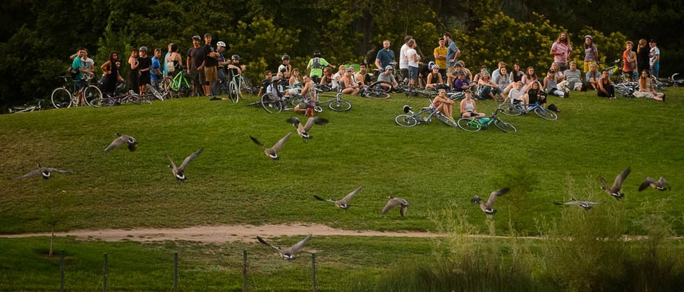 (Trent Nelson | The Salt Lake Tribune) Cyclists gather and ride around Salt Lake City's Liberty Park, Saturday July 21, 2018, in remembrance of Cameron Hooyer, a rider who was killed by a FrontRunner train during a 999 Ride on Thursday.