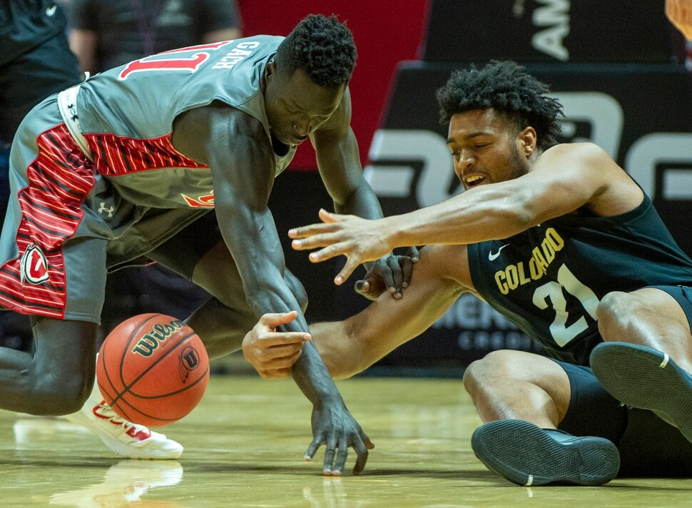 (Rick Egan | The Salt Lake Tribune) Utah Utes forward Both Gach (11) goes for a loose ball along with Colorado Buffaloes forward Evan Battey (21), in PAC-12 basketball action between the Utah Utes and the Colorado Buffaloes at the Jon M. Huntsman Center, Sunday, Jan. 20, 2019.