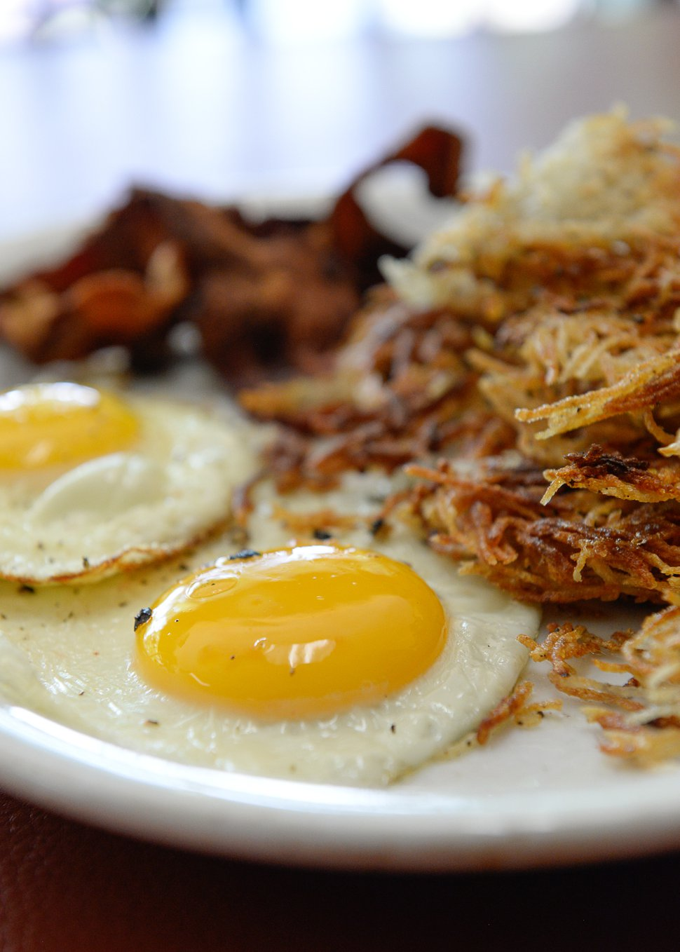 (Francisco Kjolseth   The Salt Lake Tribune) The Twin Suns breakfast includes two eggs — sunny side up — hashbrowns, choice of breakfast meat and fresh fruit on the side.