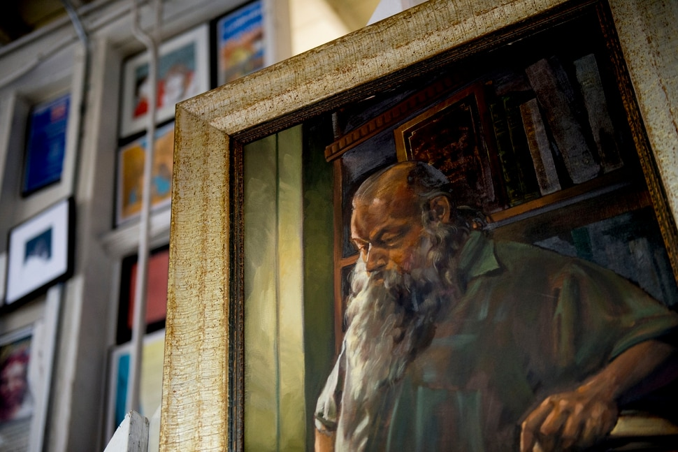 (Jeremy Harmon | The Salt Lake Tribune) A painting of Ken Sanders hangs on the wall in his book store in Salt Lake City on January 16, 2020.
