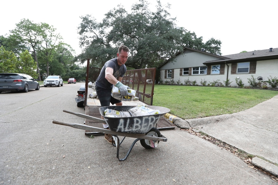 (Steve Gonzales   Houston Chronicle) Grant Gaffney unloads sandbags from a flatbed Thursday, Aug. 24, 2017, in Houston. Tropical Storm Harvey intensified Thursday into a hurricane that forecasters said would be the first major hurricane to hit Texas in 12 years.