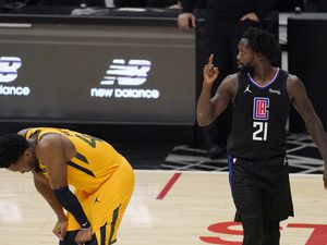 (AP Photo | Mark J. Terrill) Los Angeles Clippers guard Patrick Beverley, right, gestures after a foul that was committed by the Utah Jazz as the Jazz's guard Donovan Mitchell looks down during the second half in Game 4 of a second-round NBA basketball playoff series Monday, June 14, 2021, in Los Angeles.