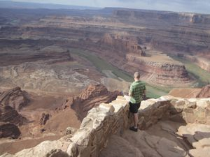 (Tribune file photo) A tourist enjoys the view from Dead Horse Point State Park, one of 44 operated by the Utah Department of Natural Resources. A bill before the Legislature to restructure the department would break its Division of Parks and Recreation into two divisions and could prioritize motorized recreation in grant making.