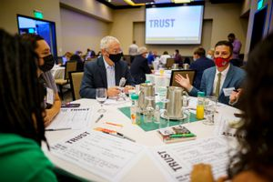 (Trent Nelson     The Salt Lake Tribune) Laura Schnurr, left, Jon Ball and Michael Parker share thoughts and ideas with group members at a Solutions Summit hosted by The Innovation Lab in West Valley City on Monday, Sept. 13, 2021.