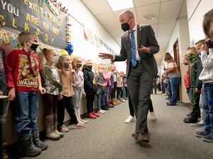 (Francisco Kjolseth  | The Salt Lake Tribune) Morgan Elementary school students line up in the halls to say hello to Gov. Spencer Cox alongside First Lady Abby Cox as they visit the Morgan School District on April 14 which marks the first 100 days of his administration. At the start of his campaign Gov. Cox set out to visit all 248 cities and towns in the state and Morgan was the first one he visited.