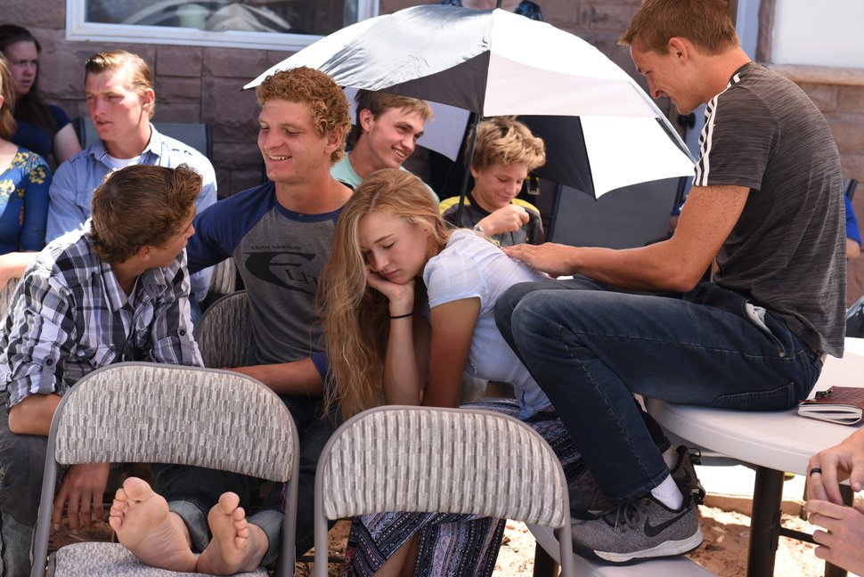 (Shannon Mullane for High Country News) One teen gets a back massage while others chat during the testimony meeting at Enoch Foster's home at Rockland Ranch on July 28, 2019.