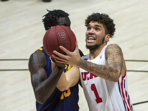 (Rick Egan | The Salt Lake Tribune) Utah Utes forward Timmy Allen (1) takes the ball to the basket as California Golden Bears forward Kuany Kuany (13) defends, in PAC12 Basketball action between the the Utah Utes and the California Golden Bears, on Wednesday, Jan. 16, 2021.