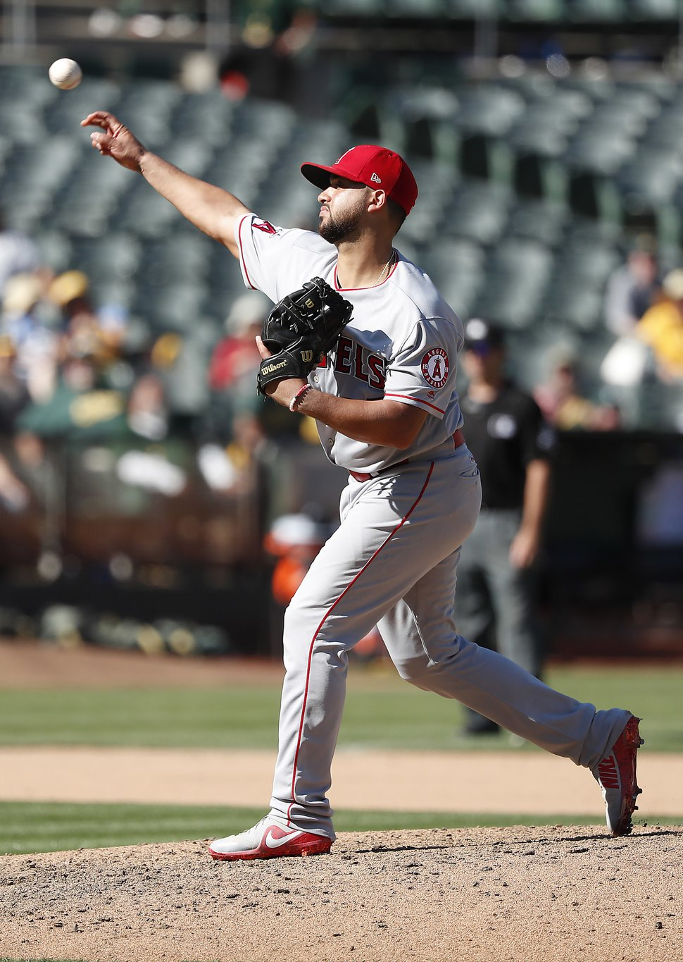 Los Angeles Angels catcher Francisco Arcia (37) pitches against the Oakland Athletics during the eighth inning in a baseball game in Oakland, Calif., Thursday, Sept. 20, 2018. Oakland won 21-3. (AP Photo/Tony Avelar)