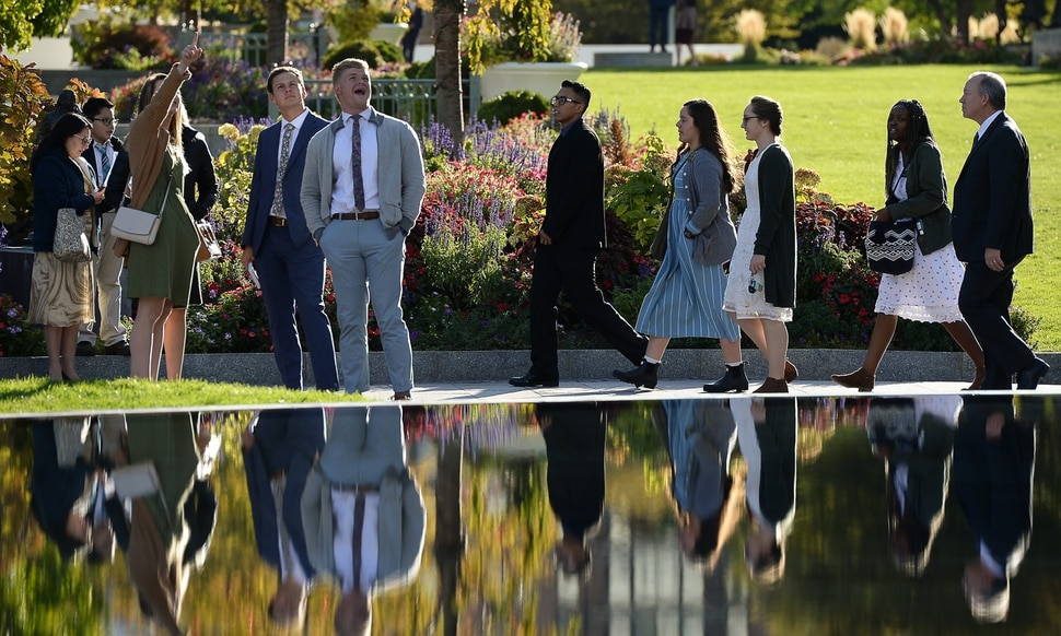 (Francisco Kjolseth | The Salt Lake Tribune) People arrive for the Sunday session of the 189th twice-annual General Conference of The Church of Jesus Christ of Latter-day Saints at the Conference Center in Salt Lake City on Sunday, Oct. 6, 2019.