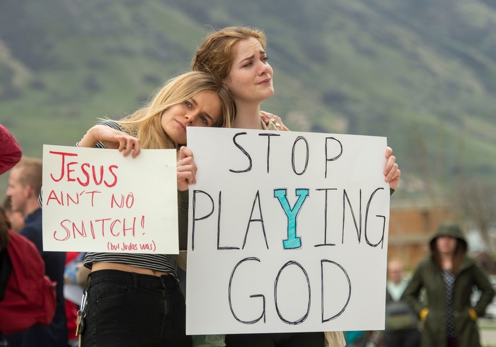 (Rick Egan | The Salt Lake Tribune) Tyler Slade and Zoe Calcote stand for a moment of silence as they gather with hundreds of BYU students in Provo to protest how the school enforces its Honor Code, Friday, April 12, 2019.