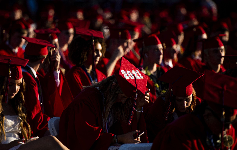 (Isaac Hale | Special to The Tribune) Graduates await the start of Herriman High School's graduation ceremony held Thursday, June 3, 2021.