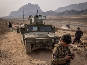 (Jim Huylebroek | The New York Times) Afghan security forces, some with uniform and others without, man a lone outpost near Panjwai, Afghanistan, Jan. 30, 2021.