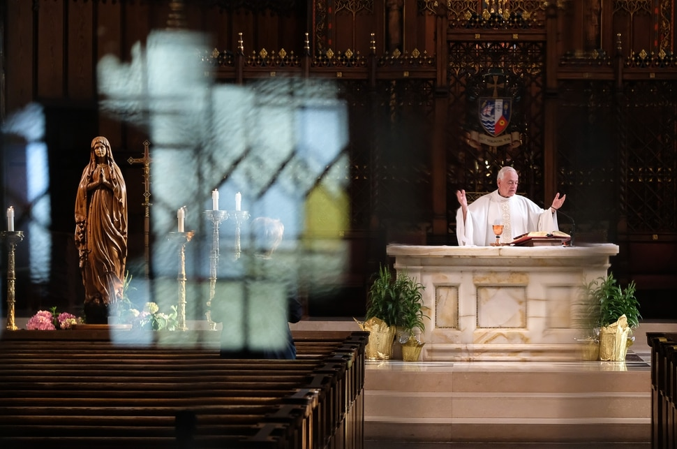 (Francisco Kjolseth | The Salt Lake Tribune) Father Martin Diaz, pastor of Cathedral of the Madeleine in Salt Lake City, celebrates daily Mass on Friday, May 8, 2020, where numerous restrictions have been put in place due to COVID-19.