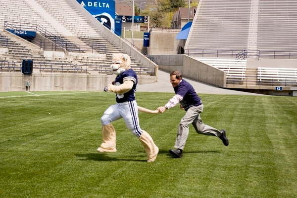 (Tribune file photo) Provo Mayor John R. Curtis grabs Brigham Young University mascot Cosmo Cougar's tail at LaVell Edwards Stadium Friday May 7, 2010. Playing with Cosmo was one of many activities Curtis did on his 50th birthday to debunk a website's declaration that Provo was the least-fun city in America.