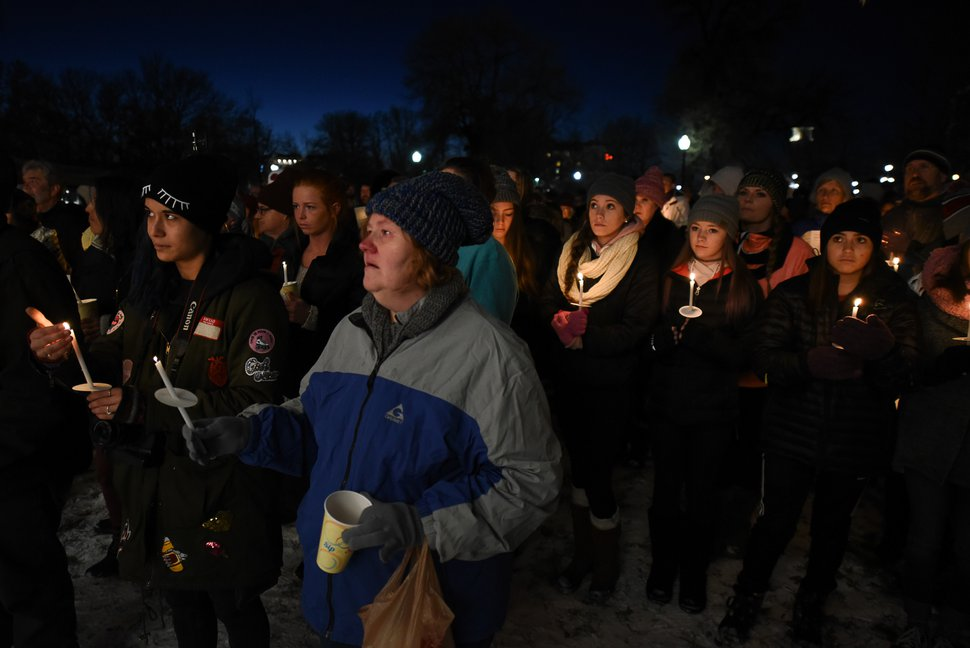 (Francisco Kjolseth | The Salt Lake Tribune) People attend a candle light vigil during the