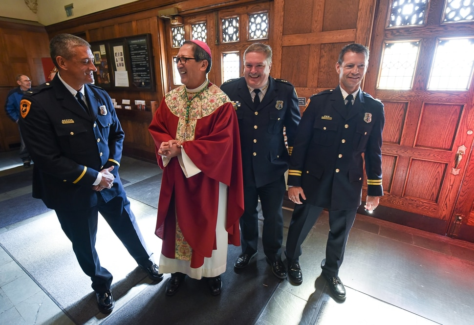 (Francisco Kjolseth | The Salt Lake Tribune) Bishop Oscar Solis meets Salt Lake Police Department members Lt. Martin Kaufmann, Asst. Captain Tim Doubt and Captain Lance Vandongen, from left, following a service for Utah's legal and criminal justice communities who were invited to participate Wednesday, Oct. 11, in a Red Mass at the Cathedral of the Madeleine in Salt Lake City. The mass, named for the red vestments worn by officiating clergy, goes back to the Middle Ages and traditional invokes the Holy Spirit's aid in dispensing justice.