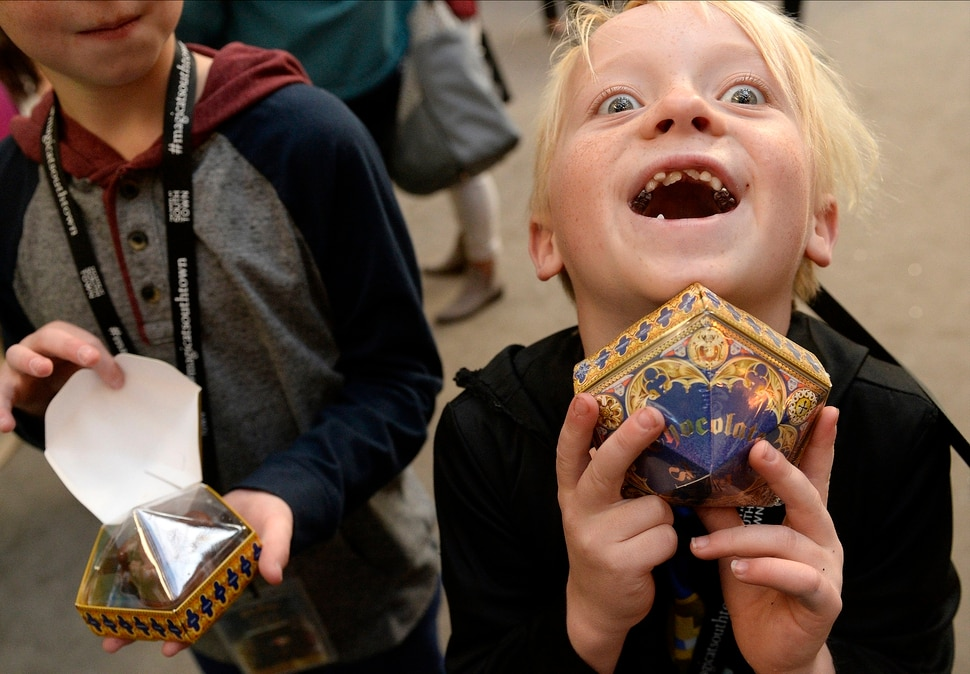 (Al Hartmann | The Salt Lake Tribune) Young wizard Charlie Woolenzien, 7, is excited to finds a box of chocolate frogs at Warner Bros. Harry Potter-themed exhibit and shopping area in the Shops at South Town in Sandy. There are interactive activities in addition to Harry Potter and Fantastic Beasts and Where to Find Them merchandise.