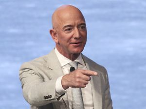 (Charles Krupa   AP file photo)  In this June 19, 2019, photo, Amazon founder Jeff Bezos speaks during the JFK Space Summit at the John F. Kennedy Presidential Library in Boston.
