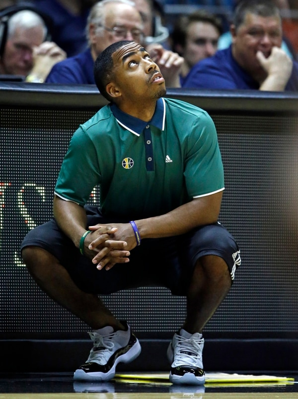 Utah Jazz coach Johnnie Bryant looks at the scoreboard during the second half of an NBA summer league basketball game against the Philadelphia 76ers on Thursday, July 7, 2016, in Salt Lake City. (AP Photo/Rick Bowmer)
