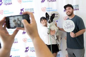 (Leah Hogsten  |  The Salt Lake Tribune) l-r Marley Colt and boyfriend Jon McFarland are all smiles after adopting Baxter, a 1-year-old heeler mix, during the Humane Society's weeklong adoption event, Clear the Shelters, Saturday, August 19, 2017, a nationwide drive to adopt out cats and dogs.