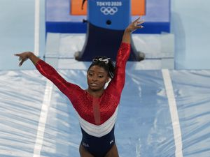 (Natacha Pisarenko | AP) Simone Biles, of the United States, dismounts from the vault during the artistic gymnastics women's final at the 2020 Summer Olympics, Tuesday, July 27, 2021, in Tokyo.
